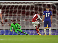 Football - 2020 / 2021 Premier League - Arsenal v Chelsea - Emirates Stadium<br /> <br /> Alexandre Lacazette of Arsenal  scoring goal no 1 from the penalty spot past goalkeeper, Edouard Mendy<br /> <br /> COLORSPORT/ANDREW COWIE