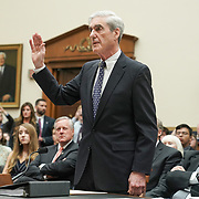 Former special counsel Robert Mueller is sworn in before testifying to the House Judiciary Committee about his report on Russian interference in the 2016 presidential election on Wednesday, July 24, 2019.