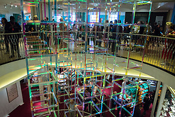 London, UK. 13 September, 2019. Liz West's Iri-Descent has been installed in the atrium of the historic Fortnum & Mason store in Piccadilly as a Festival Commission for the London Design Festival. The installation comprises a suspended arrangement of 150 skeleton-framework cubes clad with dichromatic film in two differing colourways. The cubes appear to change colour as visitors move around the atrium and between the floors above and below.