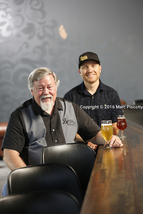 SHOT 7/22/16 1:58:37 PM - Bruz Beers co-founders Charlie Gottenkieny and Ryan Evans inside the new brewery near 67th Avenue and Pecos in Denver, Co. Bruz Beers is Denver's artisanal Belgian-style brewery, featuring a full line of traditional and Belgian-inspired brews, hand-crafted in small batches. Includes images of Evan's dog 'Cooper' as well who serves as the brewery dog. (Photo by Marc Piscotty / © 2016)