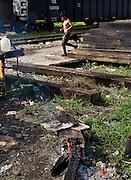 "A central american migrant runs towards the train, nicknamed ""La Bestia"". (Photo: Prometeo Lucero)"