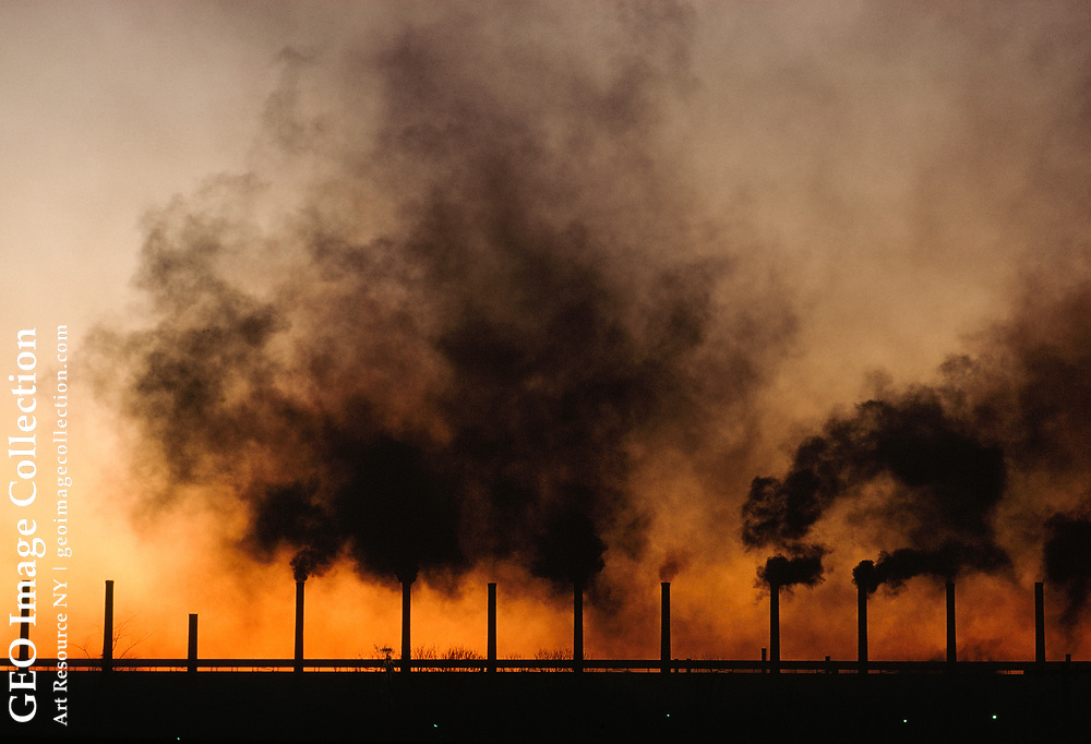 Fumes billow from a factory creating horrible air pollution.
