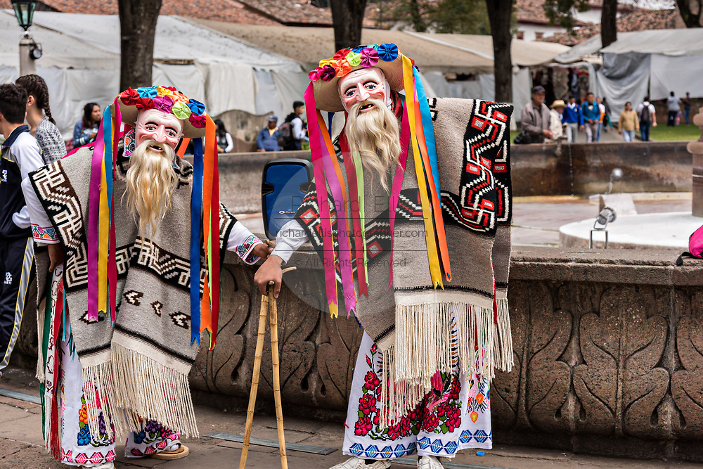 Two costumed performers dressed for the Danza de los Viejitos or Dance of the Little Old Men pose during the Day of the Dead festival October 31, 2017 in Patzcuaro, Michoacan, Mexico.