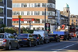 © Licensed to London News Pictures. 29/09/2021. London, UK. Motorists queue for the sixth day of the fuel crisis at Texaco petrol station in north London, amid fears of fuel running out due to a shortage of HGV drivers. According to the government, 75 army tanker drivers have been put on standby to deliver motor fuel in order to ease the chaos at petrol stations. Photo credit: Dinendra Haria/LNP