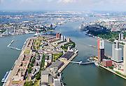 Nederland, Zuid-Holland, Rotterdam, 10-06-2015; Katendrecht, bijgenaamd De Kaap, met pakhuizen en silo's aan de Veerlaan. Links de Maashaven, rechts de Rijnhaven en met de Rijnhavenbrug naar de Wilhelminakade. Niuewe Maas in het verschiet.<br /> Katendrecht peninsula, former port quarter.<br /> luchtfoto (toeslag op standard tarieven);<br /> aerial photo (additional fee required);<br /> copyright foto/photo Siebe Swart