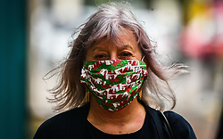 © Licensed to London News Pictures. 08/09/2020. Caerphilly, Wales, UK. Resident, Anne Jones in a Welsh flag mask  in the town of Caerphilly in south Wales, which has gone into lockdown along with it's wider borough area, after what is being described as a rapid increase in coronavirus cases. The Welsh government announced that from 6pm on Tuesday people will not be able to leave or enter the area without good reason, along with other restrictive measures.<br />  Photo credit: Robert Melen/LNP