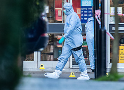 © Licensed to London News Pictures. 03/02/2020. London, UK. Evidence markers are placed on the ground outside Boots where the assailant was shot in Streatham High Road the day after he stabbed two people. Sudesh Amman, who was released from prison recently for terror offences, was under active police surveillance at the time of the attack - which police think was an Islamist-related terrorist incident. Photo credit: Peter Macdiarmid/LNP