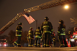 Chicago firefighters wait under a flag near the Medical Examiners office at Leavitt and West Harrison streets in Chicago on November 19, 2018. A Chicago police officer was killed at Mercy Hospital today. Photo by Armando Sanchez/Chicago Tribune/TNS/ABACAPRESS.COM