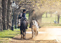 Licensed to London News Pictures. 20/04/2021. London, UK. Riders enjoy the warm hazy sunshine in Hyde Park, London this morning a week after the easing of Covid-19 restrictions. A mini heatwave has hit the UK this week with temperatures reaching over 18c in London and the South East yesterday. Photo credit: Alex Lentati/LNP