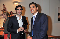 Left to right, WILLIAM MORE-NISBETT and TOM HEWITT at a party to celebrate the launch of the new Mauritius Collection of jewellery by Forbes Mavros held at Patrick Mavros, 104-106 Fulham Road, London SW3 on 5th July 2011.