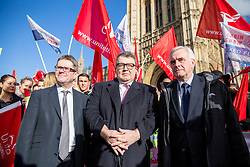 © Licensed to London News Pictures. 07/02/2017. London, UK. Deputy Leader of the Labour Party TOM WATSON (centre) and Shadow Chancellor of the Exchequer JOHN MCDONNELL (right) attend a demonstration by British Airways cabin crew. Striking cabin crew working for the airline's mixed fleet demonstrate with flags and placards outside parliament today, seeking MPs' support for a higher wage. Photo credit : Tom Nicholson/LNP