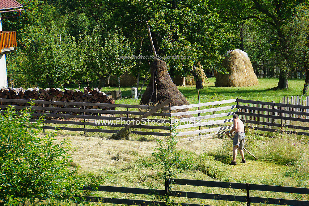man works in his field in rural Romania