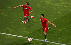 Portugal's Goncalo Guedes (right) celebrates scoring his side's first goal of the game with team-mate Bernardo Silva during the Nations League Final at Estadio do Dragao, Porto.