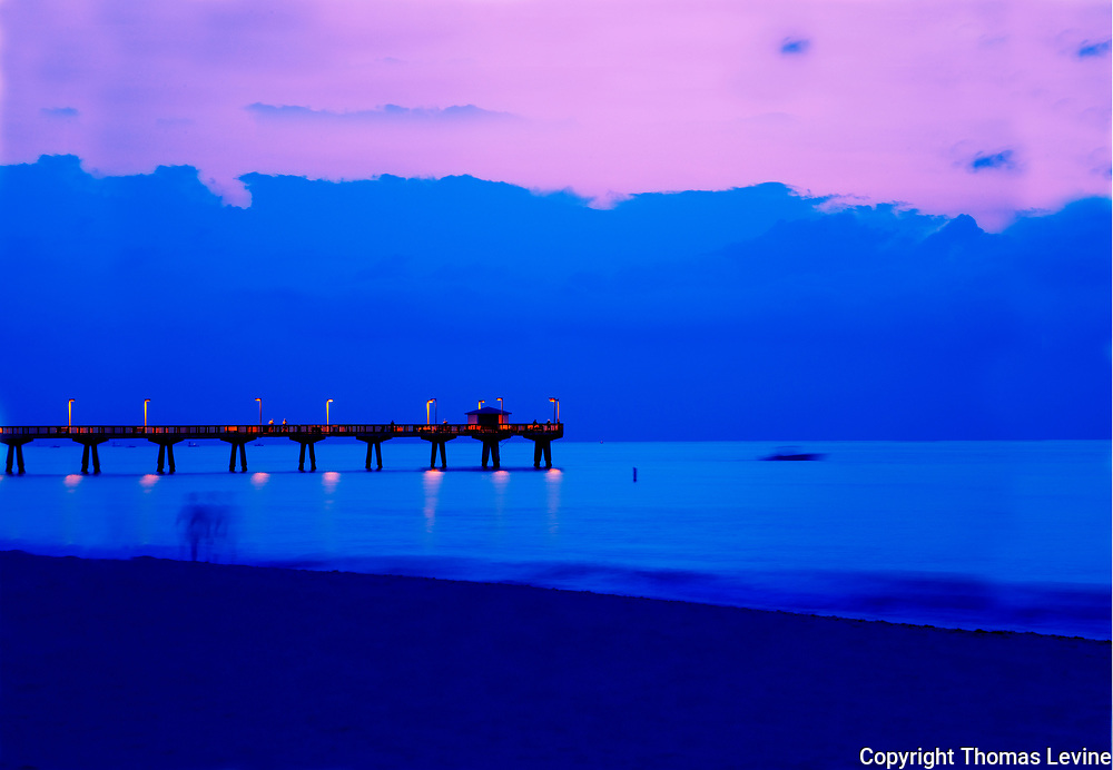 Fine Art: <br /> <br /> Pompano Pier 2005: I  like mixing cold tones with warm tones and sharp and motion in the same image. The boat, sea and person is constantly moving.