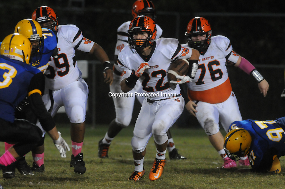 New Hanover's Keegan Santos rushes against Laney Friday October 17, 2014. (Jason A. Frizzelle)