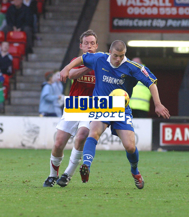 Photo: Dave Linney.<br />Walsall v Torquay United. Coca Cola League 2. 04/11/2006 Walsall's .Darren Wrack(L) keeps a close watch on  Lee Andrews.