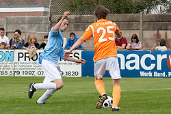 © Licensed to London News Pictures . 02/08/2015 . Droylsden Football Club , Manchester , UK . Twins ELLIOTT and LUKE TITTENSOR , on opposing teams , compete for the ball . Celebrity football match in aid of Once Upon a Smile and Debra , featuring teams of soap stars . Photo credit : Joel Goodman/LNP