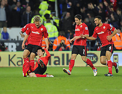 Cardiff City Midfielder, Kim Bo-Kyung (KOR) celebrates scoring a dramatic equaliser with his team mates - Photo mandatory by-line: Joseph Meredith/JMP - Tel: Mobile: 07966 386802 - 24/11/2013 - SPORT - FOOTBALL - Cardiff City Stadium - Cardiff City v Manchester United - Barclays Premier League.
