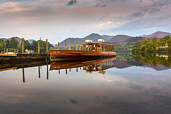 © Licensed to London News Pictures. 15/09/2020. Keswick UK. Boats reflect into the still water of Derwentwater in Keswick, Cumbria at first light this morning. Photo credit: Andrew McCaren/LNP