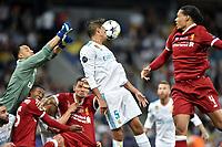 KIEV, UKRAINE - MAY 26: Keylor Navas, Raphael Varane of Real Madrid compete with Virgil Van Dijk of Liverpool during the UEFA Champions League final between Real Madrid and Liverpool at NSC Olimpiyskiy Stadium on May 26, 2018 in Kiev, Ukraine. (MB Media)