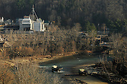 Trucks cross the White River in Bethel toward the train yard to pick up gravel and stone to take to Vermont Route 107 to repair flood damage from Tropical Storm Irene Tuesday, November 8, 2011. <br /> Valley News - James M. Patterson<br /> jpatterson@vnews.com<br /> photo@vnews.com