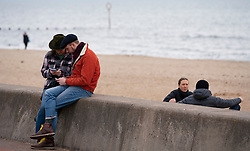 Portobello, Edinburgh, Scotland, UK. 5 April, 2020.  Images of Portobello promenade on the second Sunday of the coronavirus lockdown in the UK. Couples not maintaining social distancing.