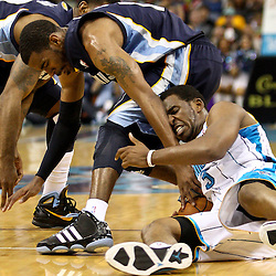 April 1, 2011; New Orleans, LA, USA; New Orleans Hornets point guard Chris Paul (3) and Memphis Grizzlies point guard Mike Conley (11) scramble for a loose ball during the second half at the New Orleans Arena. The Grizzlies defeated the Hornets 93-81.   Mandatory Credit: Derick E. Hingle