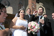 Brooklyn, N.Y.  The wedding ceremony of Christine Neve and Vincent Brace at Saints Simon and Judes R.C. Church on Ave T. Blowing bubbles outside the church after the ceremony.