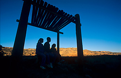 Family watching the sunset over Palo Duro Canyon