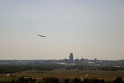 01 July 2006  A quick vacation through Iowa to Omaha.  ..jet aircraft leaving Eppley Field airport at Omaha Nebraska. Viewed from the Lewis and Clark monument in Council Bluffs Iowa.