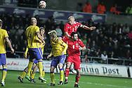 James Collins of Wales wins a header. International friendly, Wales v Sweden at the Liberty Stadium in Swansea on Wed 3rd March 2010. pic  by  Andrew Orchard