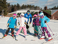 Jeff Thibault and his Camp IV girls are all smiles as they head out for their All Mountain Base Camp Lesson on Wednesday morning.  (Karen Bobotas/for the Laconia Daily Sun)