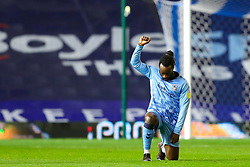 Fankaty Dabo of Coventry City raises his fist while taking the knee - Mandatory by-line: Nick Browning/JMP - 20/11/2020 - FOOTBALL - St Andrews - Birmingham, England - Coventry City v Birmingham City - Sky Bet Championship