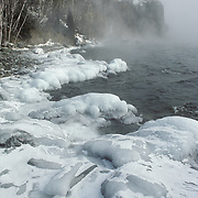 Split Rock Lighthouse on Lake Superior in Minnesota. Icy shores are created by open water.