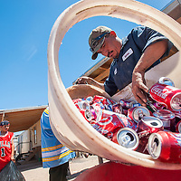 062613       Cable Hoover<br /> <br /> Employee Robert Pabon, right, sorts through customers' aluminum cans at All City Recycling in Gallup Wednesday.