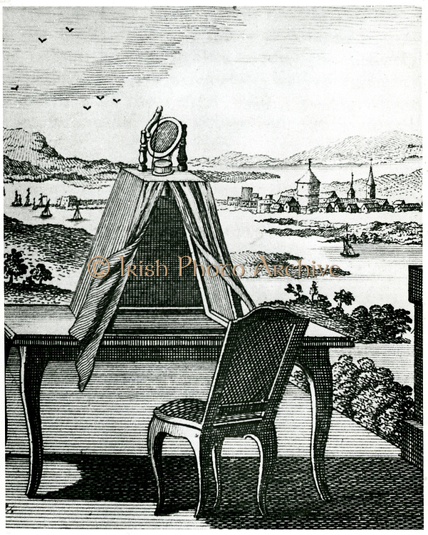 Portable tent type of camera obscura placed on a table so that it could be used to draw the landscape projected down onto sheet of white paper on table. From 'The Complete Dictionary of Arts and Sciences', edited T.H. Crocker, T. Williams and S. Clarke, London, 1764. Engraving