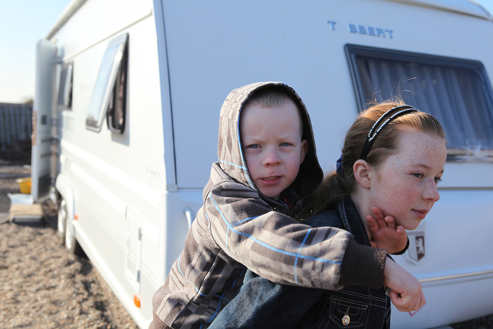 Irish Travellers girl holding her brother in Dale Farm, the largest Traveller community in the UK, Dale Farm was under threat of bulldozing. Ninety families were facing the largest eviction of its kind in recent memory, a nightmare which would force its residents to camp again on roadsides and car-parks. The site was eventually violently evicted in October 2011.