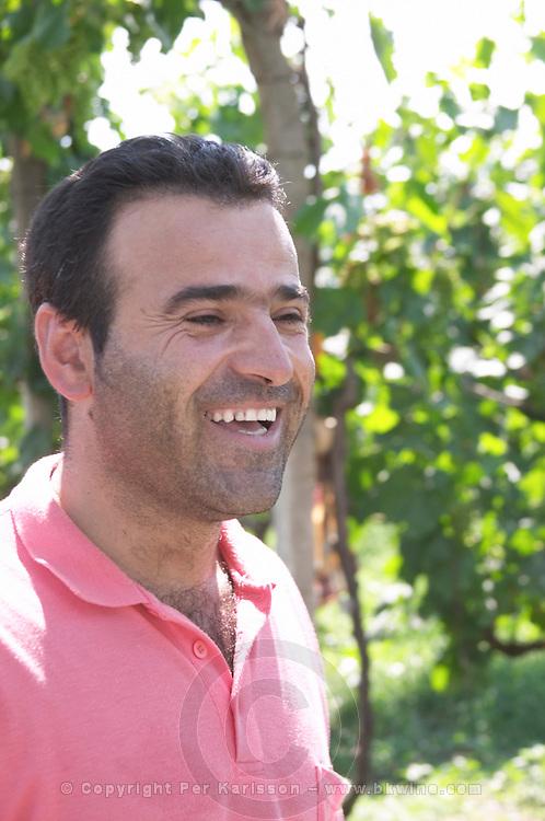 Mr Petrit Cobo, one of the two brothers running the winery, in the vineyard. Cobo winery, Poshnje, Berat. Albania, Balkan, Europe.
