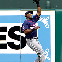 26 August 2007:  Minnesota Twins center fielder Torii Hunter (48) makes a running catch in the 3rd inning on a line drive off the bat of Baltimore Orioles shortstop Miguel Tejada (10).  The Twins defeated the Orioles 11-3 at Camden Yards in Baltimore, MD.