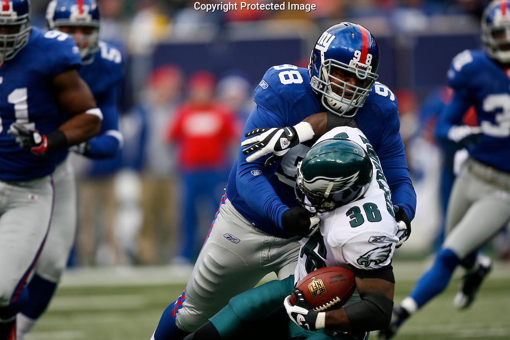 7 Dec 2008: Philadelphia Eagles running back Brian Westbrook #36 is taken down by New York Giants defensive tackle Fred Robbins #98 during the game against the New York Giants on December 7th, 2008. The Eagles won 20-14 at Giants Stadium in East Rutherford, New Jersey.