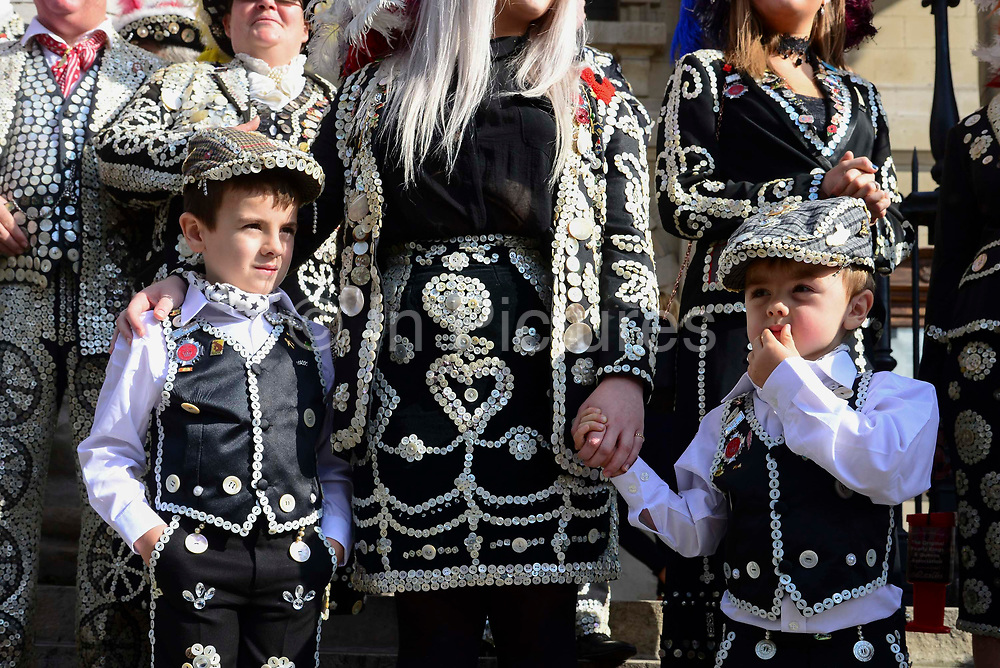 Pearly princes at St Martin-in-the-Fields church for their annual Harvest Festival on 6th October 2019 in London, United Kingdom. The tradition of the Pearly Kings and Queens originated in the 19th century when London street sweeper Henry Croft decorated his uniform and began collecting money for charity. The annual harvest festival sees Pearly Kings and Queens gather to celebrate the autumn harvest with a church service.