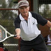 Mose Harvey, New Zealand, in action against George Sarantos, USA,  during the Jack Crawford Cup match during the 2009 ITF Super-Seniors World Team and Individual Championships at Perth, Western Australia, between 2-15th November, 2009.