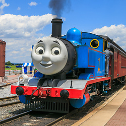 Strasburg, PA, USA - June 20, 2017:  Thomas the Tank Engine chugs into the train station in Strasburg, Lancaster County.