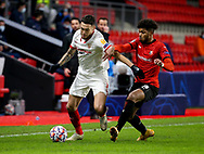 Lucas Ocampos of Sevilla FC, Georginio Rutter of Stade Rennais during the UEFA Champions League, Group E football match between Stade Rennais and Sevilla FC (FC Seville) on December 8, 2020 at Roazhon Park in Rennes, France - Photo Jean Catuffe / ProSportsImages / DPPI