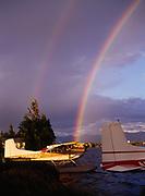 Late afternoon rainbow over Lake Hood flloatplane base with Cessna 185s, Anchorage, Alaska.
