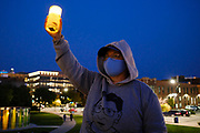 20 SEPTEMBER 2020 - DES MOINES, IOWA: A woman holds up a candle during a vigil for US Supreme Court Justice Ruth Bader Ginsburg in Poppajohn Sculpture Park in Des Moines. About 200 people attended the candlelight vigil for Justice Ruth Bader Ginsburg. Ginsburg died from pancreatic cancer on September 18, 2020.       PHOTO BY JACK KURTZ