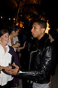 NAN BUSH; PHARRELL WILLIAMS, The Launch of Visionaire 55 Surprise in collaboration with Krug. Raleigh Hotel. Art Basel Miami Beach. 4 December 2008 *** Local Caption *** -DO NOT ARCHIVE -Copyright Photograph by Dafydd Jones. 248 Clapham Rd. London SW9 0PZ. Tel 0207 820 0771. www.dafjones.com