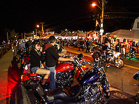 Bikes steam down Lakeside Avenue Friday evening.  (Karen Bobotas/for the Laconia Daily Sun)