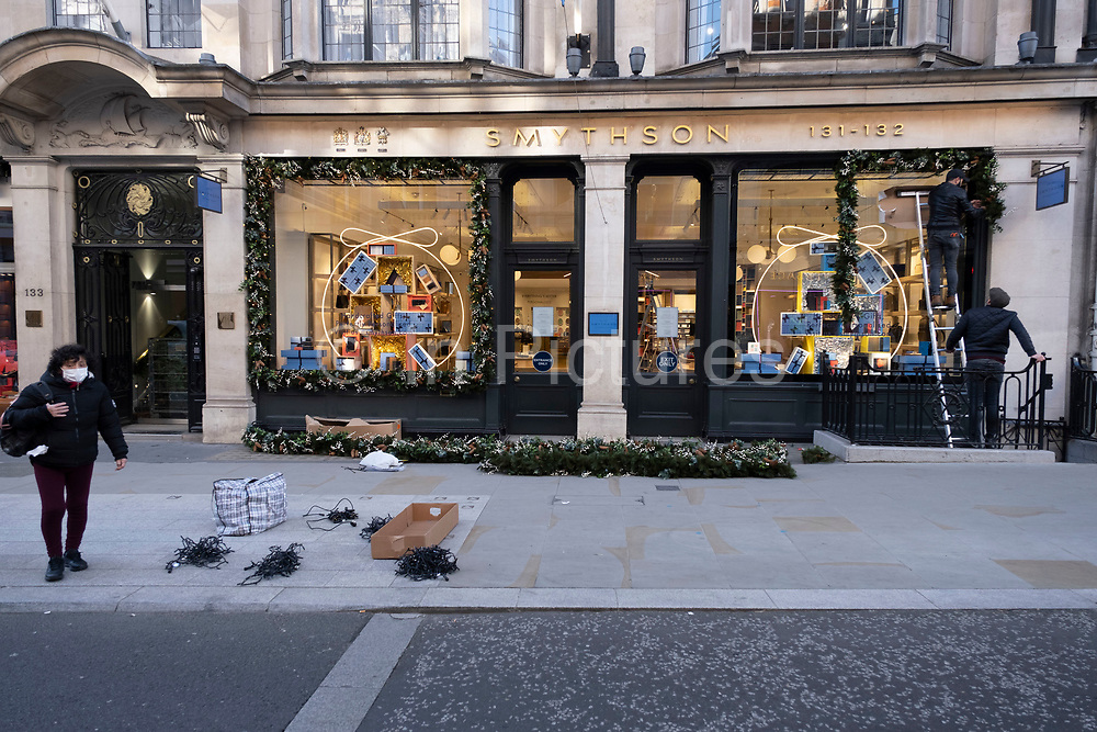 Closedshops as Christmas decorations are put up at Smythson on Bond Street as Londoners await the imminent end of the second coronavirus national lockdown before the capital enters tier two in the new three tier system on 1st December 2020 in London, United Kingdom. Non essential shops will be allowed to reopen as of 2nd December while in other areas of the country, controversially, they will have to remain closed.