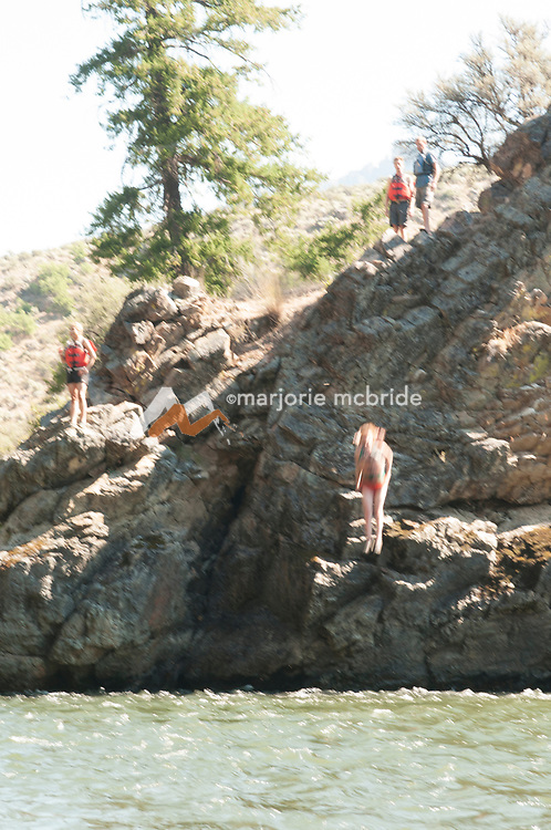 Jumping off cliff into river across from Funston camp on the Middle Fork of the Salmon River, Idaho.